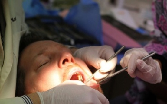 Bitter Polish dentist pulls out all of her ex-boyfriend's teeth