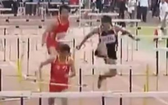 Overenthusiastic athlete 'destroys' every single hurdle during race