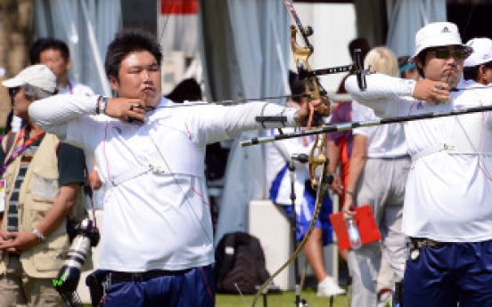 Archers begin chase for gold on opening day of London Olympics