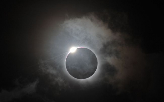 Sky-gazers in awe of total eclipse