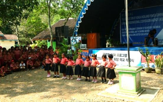 KOMIPO helps build schools in Indonesia