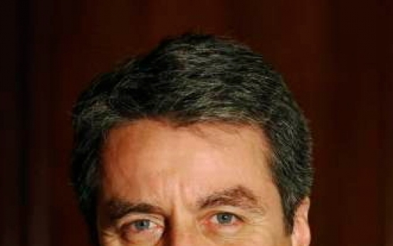 [Newsmaker] New WTO head must sell free trade message