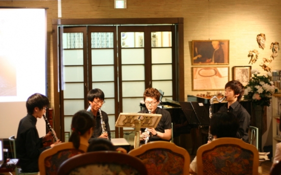 High school student forms ensemble to help hearing impaired