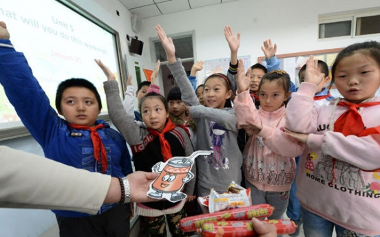 China eases up on English for students