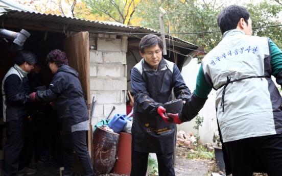 Organizations volunteer to deliver charcoal bricks