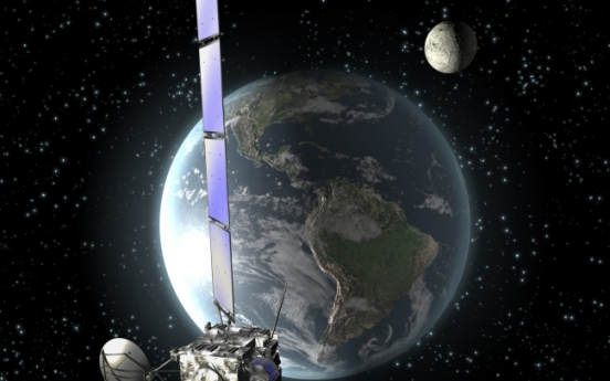Comet-chasing probe wakes up, signals Earth