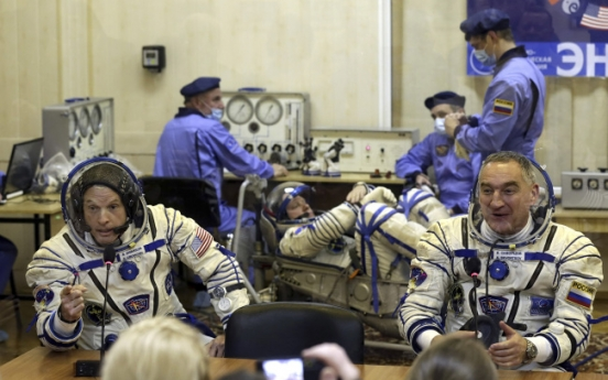 NASA cuts ties with Russia except on station