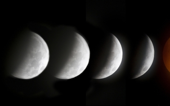 Americas get front-row seat for lunar eclipse