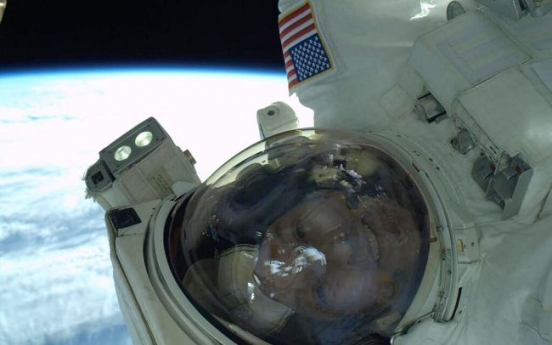 Spacewalkers replace computer outside station