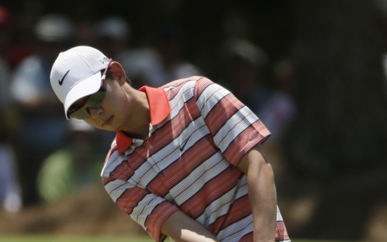 Kaymer protects lead on tough day