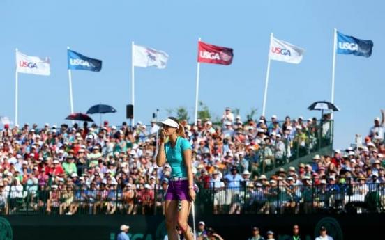Wie holds on to win Women's Open