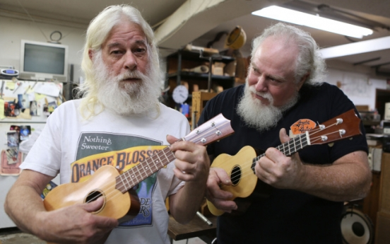 From Jimmy Buffet to Genesis ace, guitarists flock to fix-it factory