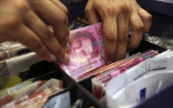 Swiss franc 'nuclear explosion' spreading