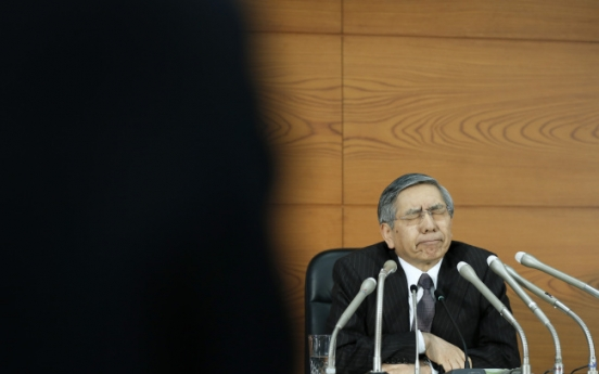 BOJ cuts inflation outlook, maintains record stimulus