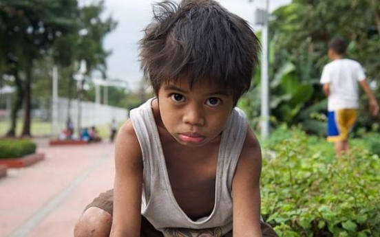 Hard life for Manila's hungry street urchins