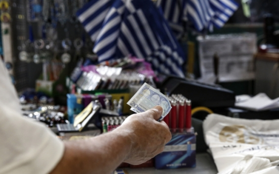Greek bailout moves ahead after Germany gives its backing