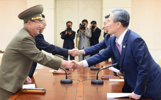 Two Koreas reach deal to ease military tensions