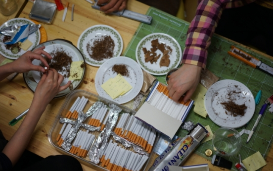 Cigarette making becomes art project