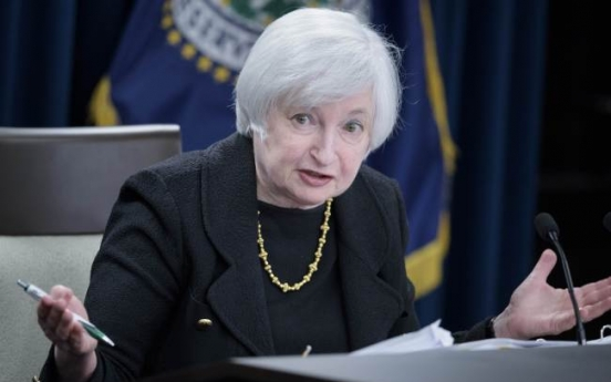 Federal Reserve holds rate at zero; cites China worries