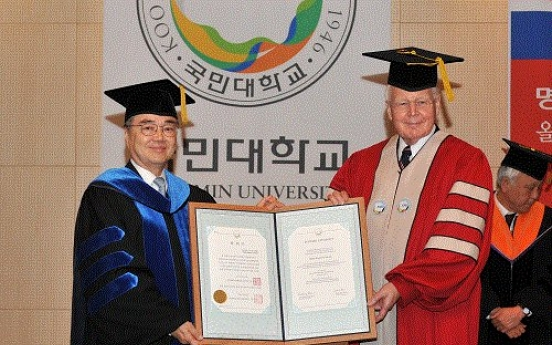 Iceland president receives honorary doctorate from Kookmin University