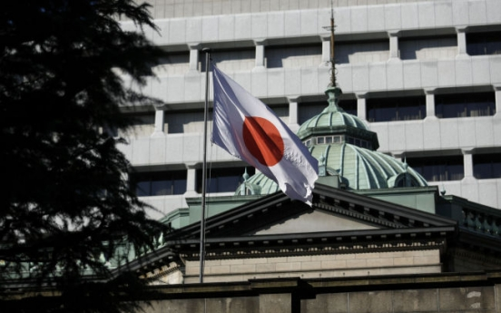 BOJ tweaks stimulus to encourage corporate spending, hiring