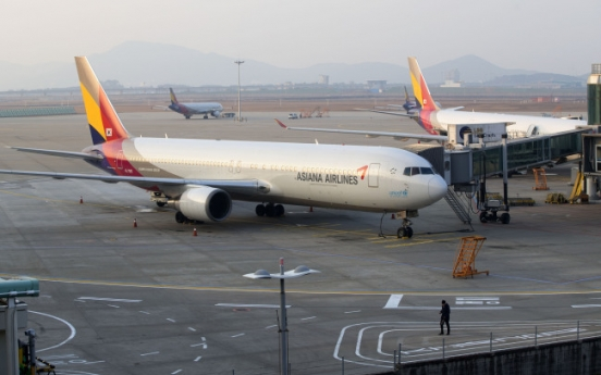 Unionized Asiana workers protest against restructuring
