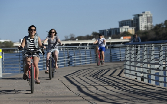 Electric bike tour gives cyclists taste of city's trendiest restaurants