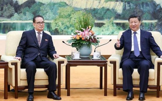 Leaders of N. Korea, China voice hope to mend ties