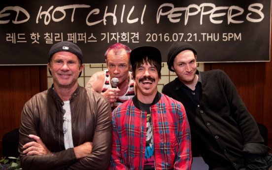 Red Hot Chili Peppers return as 'roaring beasts'