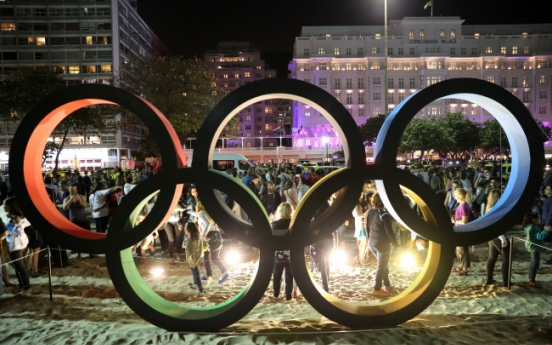 Olympics' appeal tested in grim world