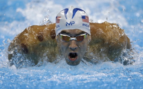 [Newsmaker] Phelps bids for astonishing 20th gold