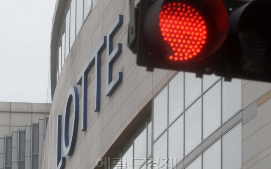 Fitch cuts Lotte Shopping's rating to 'BBB-'
