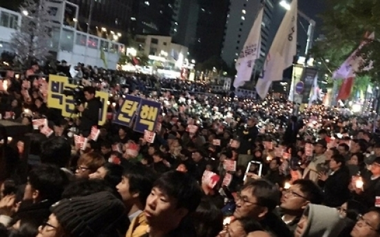 Massive protest rally held in Seoul to press Park to act