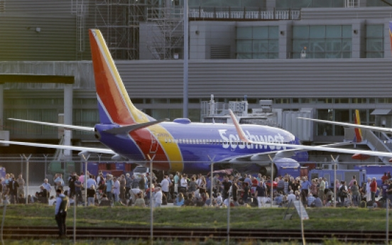 US veteran arrested in airport shooting; 5 dead, 8 wounded