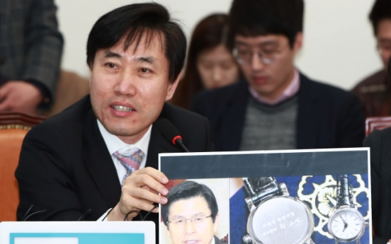 Acting President under fire over souvenir watches