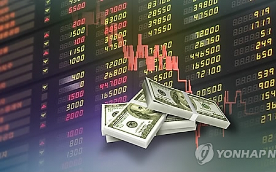 Korean stocks edge down late morning trade