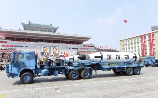 China defends N. Korea trade after its trucks haul missiles