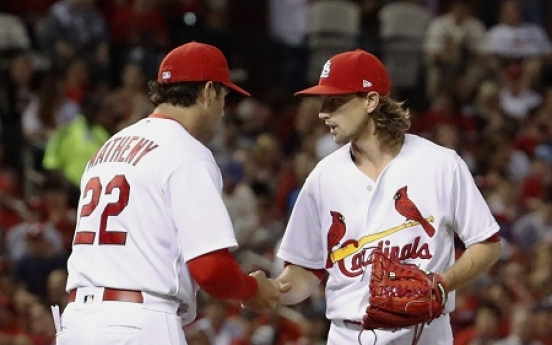 Fowler, Leake lead Cardinals past Marte-less Pirates 2-1