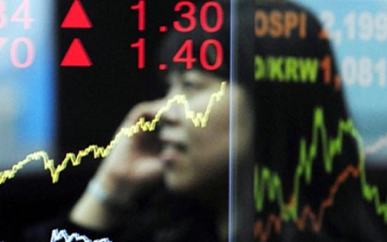 Korean stocks trade almost flat in late morning