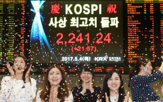 Kospi hits record-high, offsets strong dollar