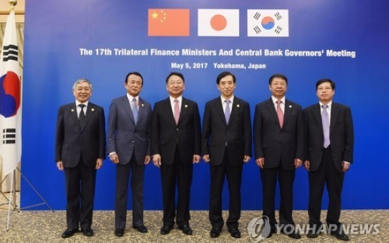 Korea, Japan, China vow to resist protectionism