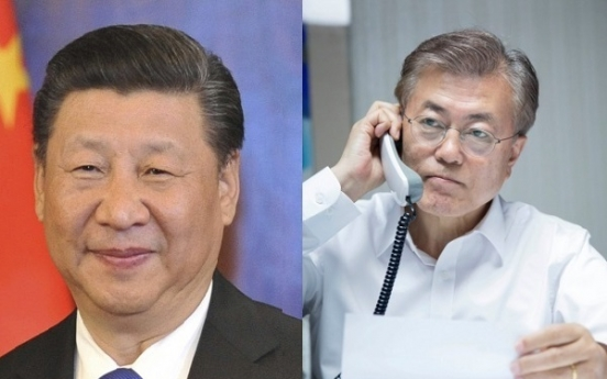 Moon and China's Xi agree to improve ties, denuclearize N. Korea