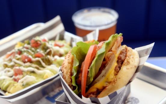 Sleeper hit expands budding burger empire