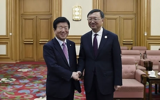 Chinese state councilor calls for efforts to recover ties with Korea under Moon admin.