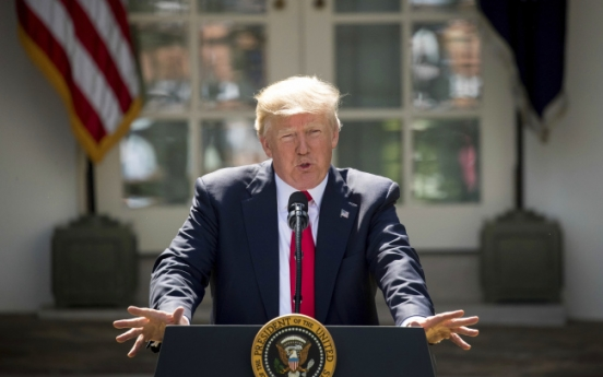 Trump pulling US from global climate pact, dismaying allies
