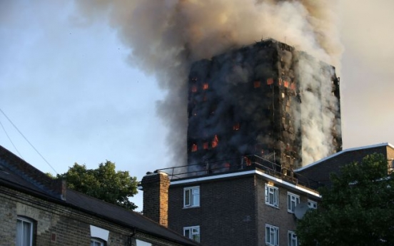 Death toll rises to 12 in London apartment building inferno