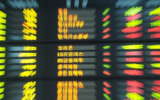Seoul shares down in late morning on tech losses
