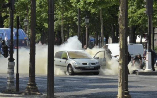 Car rams police vehicle on famed Paris avenue; attacker dies