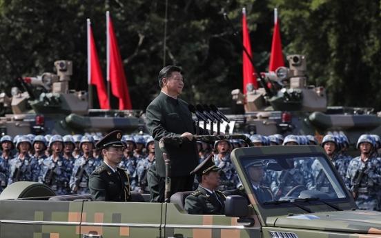 Massive military parade for Xi as Hong Kong activists freed