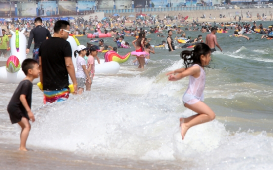 Sluggish economy means no summer holiday for 1 in 5 Koreans